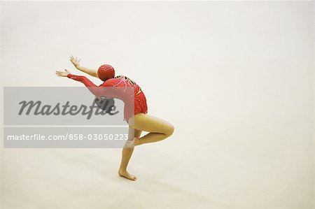 Woman performing rhythmic gymnastics with ball Stock Photo - Rights-Managed, Image code: 858-03050223