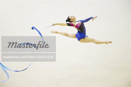 Woman performing rhythmic gymnastics with ribbon Stock Photo - Rights-Managed, Image code: 858-03050225