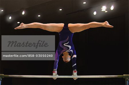 Female gymnast competing in front of a large crowd Stock Photo - Rights-Managed, Image code: 858-03050240
