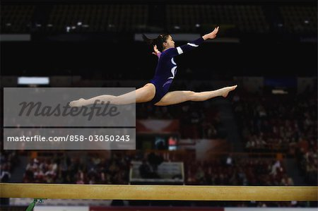Woman performing rhythmic gymnastics with ribbon Stock Photo - Rights-Managed, Image code: 858-03050243