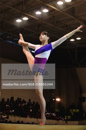 Young woman standing on balance beam Stock Photo - Rights-Managed, Image code: 858-03050244