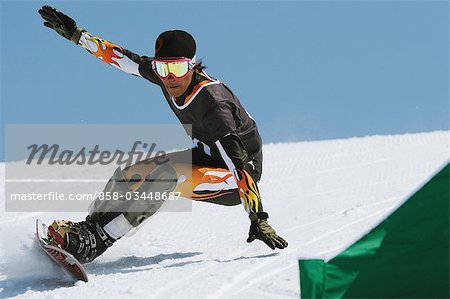 Man Snowboarding at Giant slalom Race Stock Photo - Rights-Managed, Image code: 858-03448687