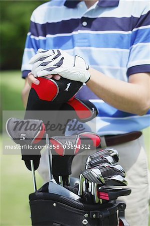 Man With Golf Club Stock Photo - Rights-Managed, Image code: 858-03694312