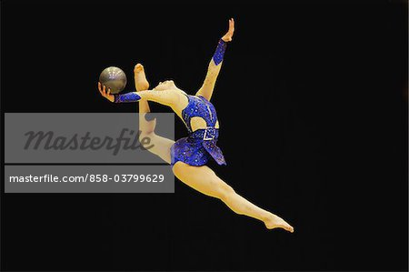 Rhythmic gymnast performing with  ball Stock Photo - Rights-Managed, Image code: 858-03799629