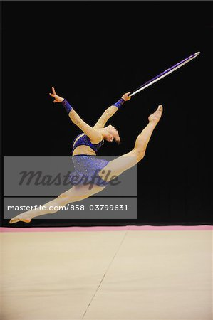 Gymnast in mid-air performing with hoop Stock Photo - Rights-Managed, Image code: 858-03799631