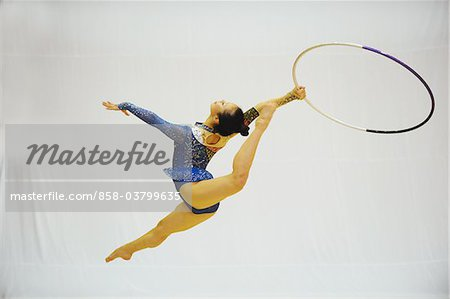 Japanese woman performing gymnastics with hoop Stock Photo - Rights-Managed, Image code: 858-03799635