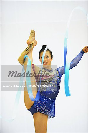 Young woman performing rhythmic gymnastics with ribbon Stock Photo - Rights-Managed, Image code: 858-03799637