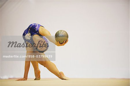 Woman performing gymnastic Stock Photo - Rights-Managed, Image code: 858-03799639