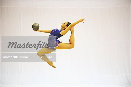 Japanese female athlete performing gymnastic with ball Stock Photo - Rights-Managed, Image code: 858-03799641