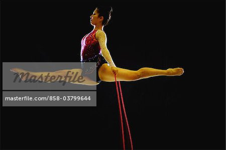 Young acrobat performing with rope Stock Photo - Rights-Managed, Image code: 858-03799644