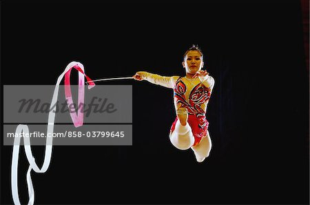 Young acrobat performing gymnastics with ribbon Stock Photo - Rights-Managed, Image code: 858-03799645