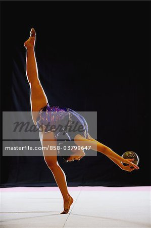 Young acrobat performing with ball Stock Photo - Rights-Managed, Image code: 858-03799647