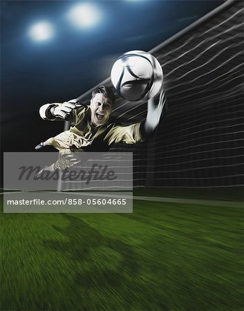 Young Goal Keeper Making a Save Stock Photo - Rights-Managed, Image code: 858-05604665