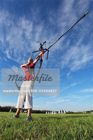 Young Female Archer Aiming at Target Stock Photo - Rights-Managed, Image code: 858-05604827