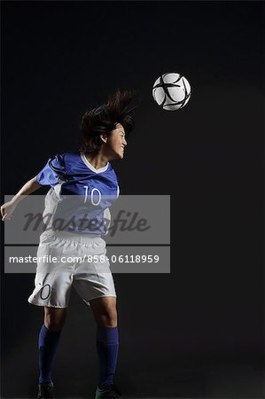 Japanese Young Sportswoman Hitting Soccer Stock Photo - Rights-Managed, Image code: 858-06118959