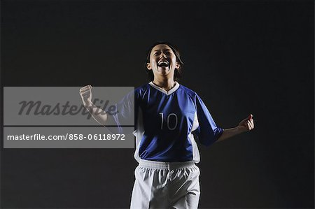 Sportswoman Showing Gesture Of Achievement Stock Photo - Rights-Managed, Image code: 858-06118972