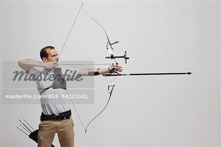 Man Archer Aiming Arrow Stock Photo - Rights-Managed, Image code: 858-06121541