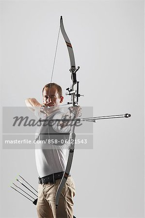 Archer Taking Aim With Bow Stock Photo - Rights-Managed, Image code: 858-06121543