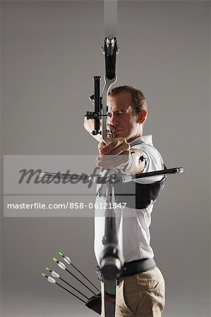 Archer Aiming Stock Photo - Rights-Managed, Image code: 858-06121547