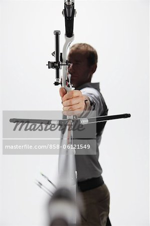 Male Archer Taking Aim Stock Photo - Rights-Managed, Image code: 858-06121549