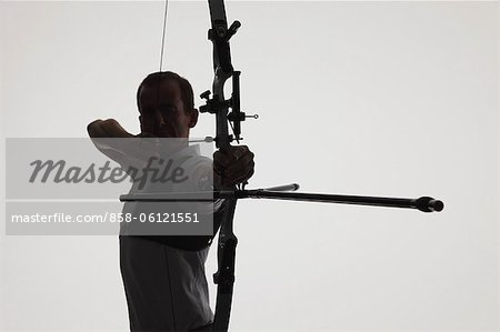 Male Archer Targeting Stock Photo - Rights-Managed, Image code: 858-06121551