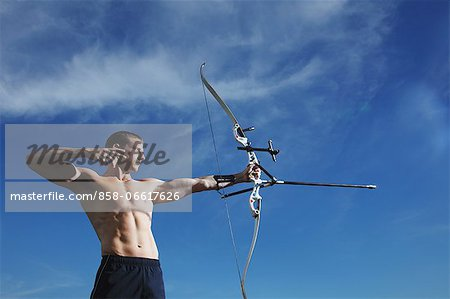 Man Practicing Archery Stock Photo - Rights-Managed, Image code: 858-06617626