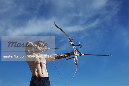 Man Practicing Archery Stock Photo - Rights-Managed, Image code: 858-06617627