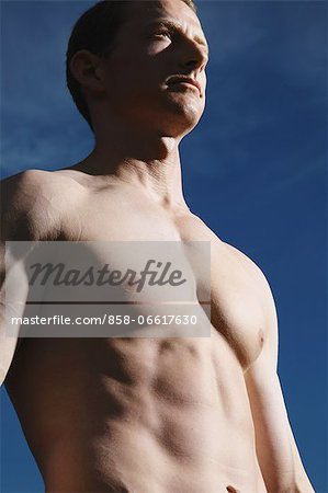 Man Showing Muscles Stock Photo - Rights-Managed, Image code: 858-06617630