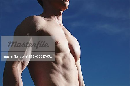 Man Showing Muscles Stock Photo - Rights-Managed, Image code: 858-06617631