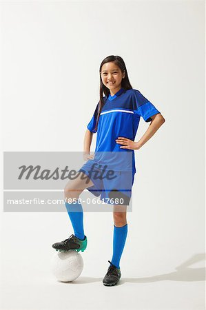 Girl Posing In Soccer Uniform With Ball Stock Photo - Rights-Managed, Image code: 858-06617680