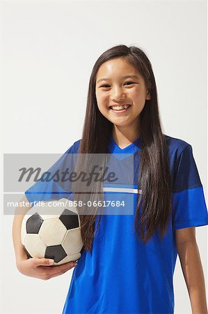 Girl Posing In Soccer Uniform With Ball Stock Photo - Rights-Managed, Image code: 858-06617684