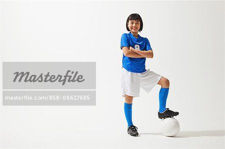 Girl Posing In Soccer Uniform With Ball Stock Photo - Rights-Managed, Image code: 858-06617685