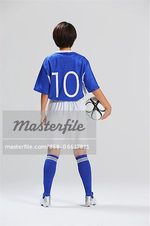 Woman In Soccer Uniform Posing With Ball Stock Photo - Rights-Managed, Image code: 858-06617811