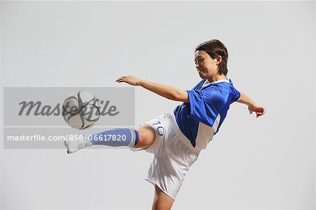 Woman In Soccer Uniform Practicing With Ball Stock Photo - Rights-Managed, Image code: 858-06617820