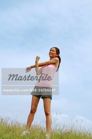 Woman Exercising In A Meadow Stock Photo - Rights-Managed, Image code: 858-06756047