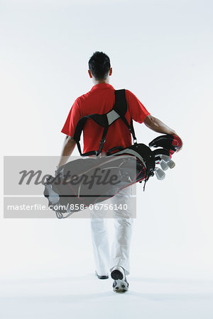 Golfer Carrying Golf-Club Bag Stock Photo - Rights-Managed, Image code: 858-06756140