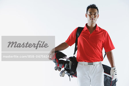 Golfer Carrying Golf-Club Bag Stock Photo - Rights-Managed, Image code: 858-06756142