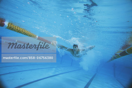Male Swimmer Underwater In Pool Stock Photo - Rights-Managed, Image code: 858-06756380