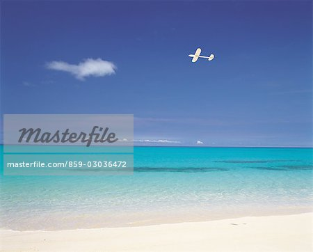 A Plane Flying Near The Coastline Stock Photo - Rights-Managed, Image code: 859-03036472