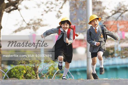Two Students Running Stock Photo - Rights-Managed, Image code: 859-03037498