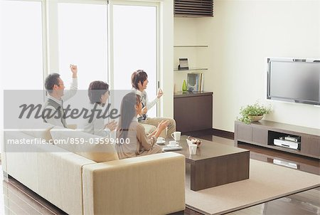 Family Watching TV Stock Photo - Rights-Managed, Image code: 859-03599400