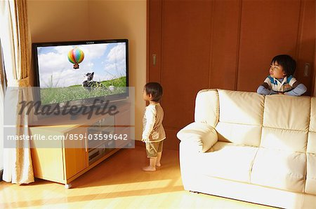 Children Watching TV Stock Photo - Rights-Managed, Image code: 859-03599642