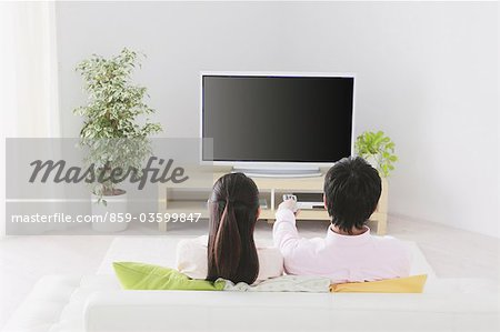 Japanese Couple Watching TV Stock Photo - Rights-Managed, Image code: 859-03599847