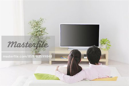 Japanese Couple Watching TV Stock Photo - Rights-Managed, Image code: 859-03599848