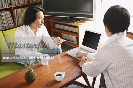 Businessman In Meeting Stock Photo - Rights-Managed, Image code: 859-03600535