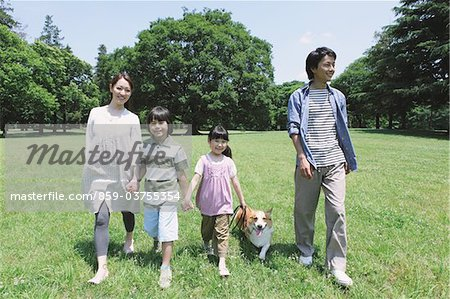 Japanese Family Having Fun In a Park Stock Photo - Rights-Managed, Image code: 859-03755354