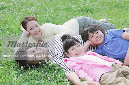 Japanese Family Resting In a Park Stock Photo - Rights-Managed, Image code: 859-03755465