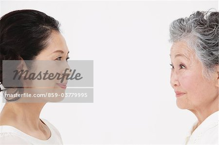 Mother And Adult Daughter Face To Face Stock Photo - Rights-Managed, Image code: 859-03779995