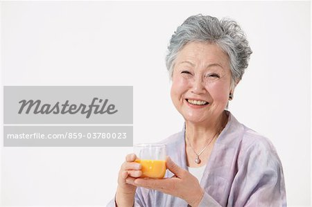 Senior Woman Holding Glass Of Juice Stock Photo - Rights-Managed, Image code: 859-03780023