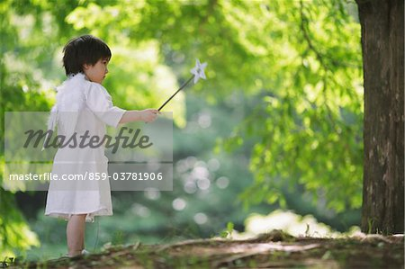 Angel Boy Standing Holding Magic Wand Stock Photo - Rights-Managed, Image code: 859-03781906